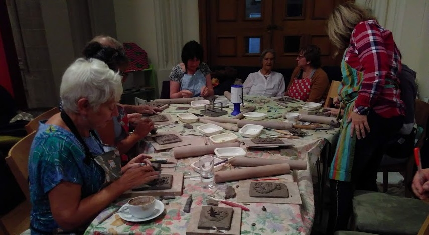 Visitors making pottery at the GRaCE cafe